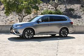 2018 mitsubishi vehicles. beautiful mitsubishi 2018 mitsubishi outlander phev first drive review front left angle and mitsubishi vehicles a