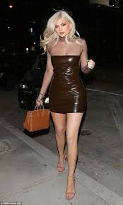 y look kylie jenner wore a tight leather dress with sheer sleeves while out in west hollywood on thursday