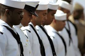 file us navy 060822 n 0555b 085 sailors awaiting the final step on final step on their road to naturalization bow their heads for a brief moment at the commencement of a u s citizenship and immigration services uscis