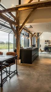 Converting an old farm into a warm industrial farmhouse with big view on an  old brick
