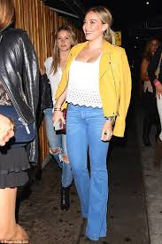 keeping it simple the former lizzie mcguire accessorised perfectly with a statement turquoise bracelet and