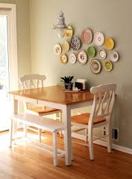 small square kitchen table: table against the wall two chairs one bench seat seating for four without