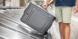 the best suitcases for checking photo caleigh waldman travel luggage