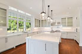 globe pendants over island. Brilliant Pendants Stunning White Kitchen Features Rejuvenation Classic Globe Pendants Over  Long Center Island Topped With Quartz Framing Square Prep Sink Accented  For Over Island