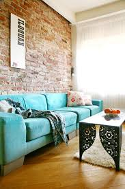 Living Room:Cool Blue Sofa In Living Room With Exposed Brick Wall Idea Cool  Blue