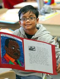 how schools keep king s dream alive in the suburbs archan sriselvakumar 7 of grayslake holds up his project on martin luther king jr