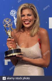 Kristen Johnston poses with her award after winning for ...