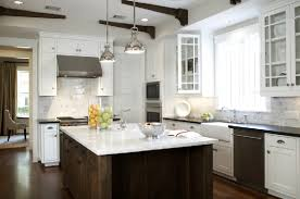 stainless steel lighting fixtures. i love dark floors white cabinets marble subway tile farmhouse sinks gas ranges schoolhouse lighting fixtures stainless steel finishes a