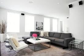 living room white leather ottoman living room contemporary with brown carpet brown rug living room