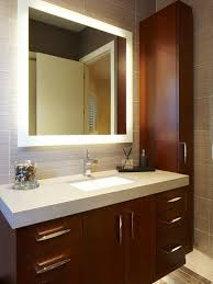 mirrored bathroom cabinets with lights. example of a trendy gray tile bathroom design in miami with an undermount sink, flat mirrored cabinets lights