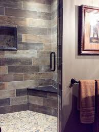 brown and gray bathroom with a warm rustic vibe beautiful tile shower with subway pattern and mosaic floor