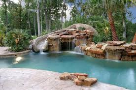 backyard pools with waterfalls and slide. Unique Waterfalls This Is A Detailed Slide With Faux Stone Design Set Into Some And  Waterfall Inside Backyard Pools With Waterfalls And Slide O