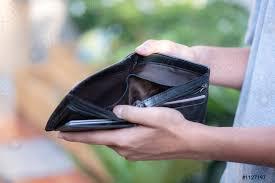 Empty wallet in the hands man - stock photo | Crushpixel
