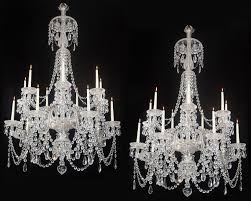a fine pair of fourteen light cut glass antique chandeliers by perry co