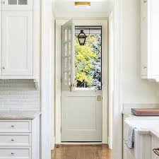 light gray dutch door with glass panes