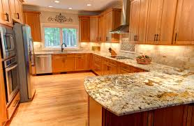 light wood flooring with recessed lighting and white ceiling also kraftmaid cabinet plus marble kitchen