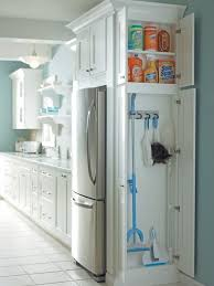 Small Kitchen Pantry Designs   Small Ceramic Floor Kitchen Pantry Photo In  Other With White Cabinets