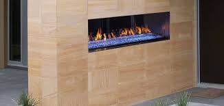 fireplace lighting. palazzo seethrough gas fireplace shown with blue led lighting