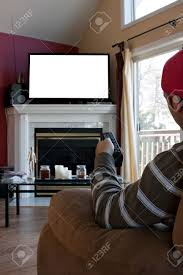 Tv In Living Room Dining Room 13452925 Bored Man Watches A Big Screen Flat Panel
