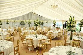 with further options circular or long dining tables a wooden floor and chandeliers in the ceiling all of our marquees come fully furnished