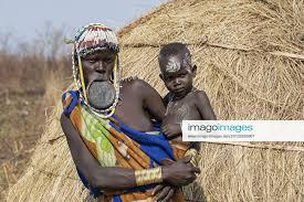 mursi tribe wearing lip plate and beads