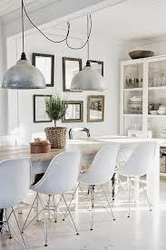 tip on how to mix styles with confidence keep it monochrome the farmhouse table mid century seating and industrial pendants look perfect together