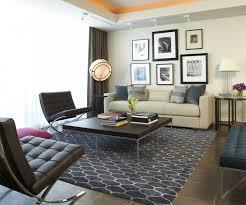 elegant living room rug inspiration blue moroccan pattern wool rug black leather swivel chair brown