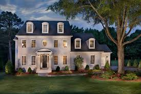 white brick house exterior traditional with beige siding statues and sculptures