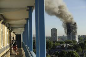 CORRECTS FLOOR NUMBER  A resident in a nearby building watches smoke rise  from a building