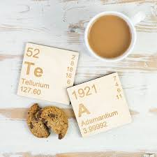 pair of wooden periodic table coasters by newton and the apple