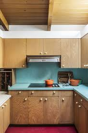 take some inspiration from this midcentury kitchen preserved in original condition where the countertop is not only a ravishing turquoise but also matches