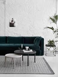 Dark Green Velvet Sofa against White Brick Wall