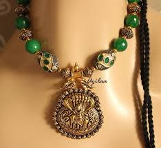 krishna pendant necklace set with green stone beads