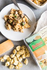this cheesy tortellini en pumpkin alfredo bake features buitoni three cheese tortellini with pan seared en t cut into bite size pieces