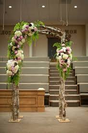 wedding arch flowers so pretty i wouldn t use pink purple though just white green brown