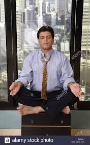 meditation office. Boss In Office Doing Yoga Meditation Peace