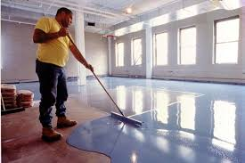 painted basement floor ideas. Man In Yellow Applies Blue Epoxy Paint To Basement Floor Painted Ideas S