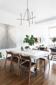 modern dining room with white table and wood dining chairs