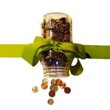 coins in mason jar with bow by jay d