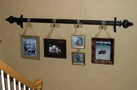 hanging empty picture frames use ribbon to hang frames from a curtain rod great idea for