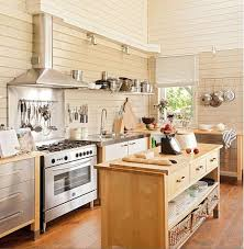 various freestanding kitchen cabinets with metal countertops make the kitchen look airy and lightweight