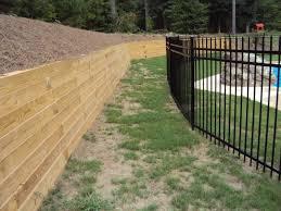 backyard pool pressure treated timber retaining wall traditional