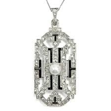 large art déco diamond pendant in platinum onyx 1920s