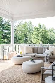 modern covered patio with low gray armless outdoor sofa and west elm pebble coffee table