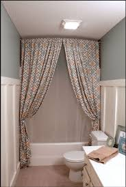hang a shower curtain all the way up to the ceiling to make the room feel bigger shower curtains ceilings big and room