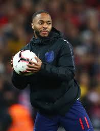 <b>Hat trick</b> scorer Raheem Sterling holds the match <b>ball</b> after the 2020...