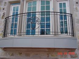 exterior classic style french balcony design using black wrought iron railing fence plus white frame
