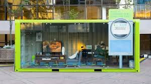office in container. actors simulate officehomes in a glass shipping container to teach energy consumption office i