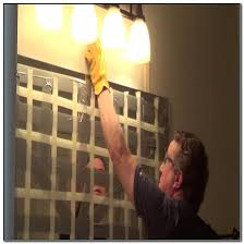 how to remove glass mirror glued to wall