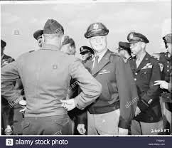 General of the Army Air Forces, Gen. Henry Hap Arnold, left, is greeted by  his son, Lt. Col. Henry Arnold who was at Gatow Airport in Berlin, Germany  where Gen. Arnold has